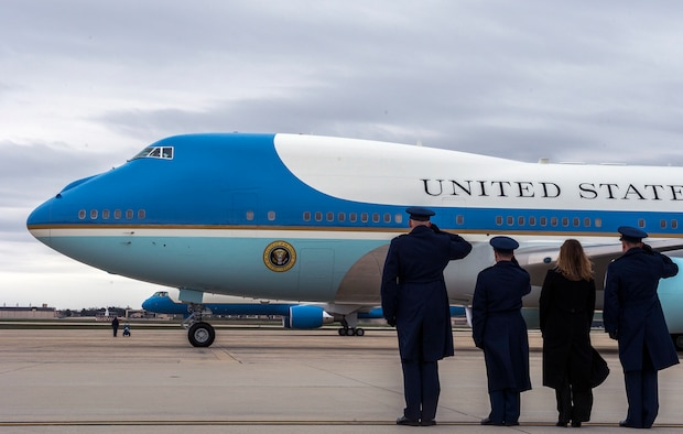 Col. Christopher Thompson, the 89th Airlift Wing vice commander, and 89th AW Airmen salute as Air Force One departs Joint Base Andrews, Md., March 20, 2016. President Barack Obama and the first family are on a two-day visit to Cuba, making history as the first U.S. president to visit Cuba in nearly 90 years. (U.S. Air Force photo/Senior Master Sgt. Kevin Wallace)