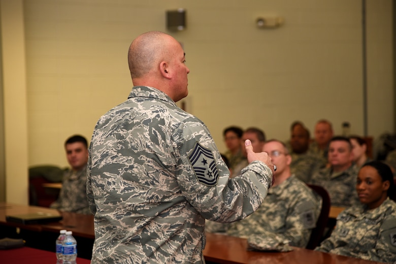 Chief Master Sgt. Mitchell O. Brush, the Senior Enlisted Advisor of the National Guard Bureau, spoke to more than 100 Airmen and Soldiers of the New Jersey National Guard at the Joint Training and Training Development Center in Joint Base McGuire-Dix-Lakehurst, New Jersey, March 20, 2016. As the top noncommissioned officer of NGB, Brush advises the Chief, National Guard Bureau on all enlisted matters affecting training, effective utilization, the health of the force, and professional development for the National Guard. (U.S. Air National Guard photo by Tech. Sgt. Armando Vasquez/Released)