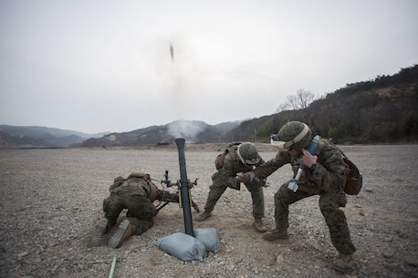 From left, U.S. Marine Corps Lance Cpl. Dave Hermansen and Lance Cpl. Jabril Giannotti, mortarmen, and Sgt. Jack Williams, a squad leader, all assigned to Weapons Co., Battalion Landing Team 1st Battalion 5th Marines, 31st Marine Expeditionary Unit, fire a 81mm training mortar with the M252A2 mortar system during Ssang Yong 16 at Suseongri, South Korea, March 15, 2016. Ssang Yong familiarizes American armed forces with the Korean Peninsula and contributes to the security and stability of the Asia-Pacific region. Hermansen is a native of Westbrook, Connecticut. Giannotti is a native of Highland Park, New Jersey. Williams is a native of Pilot Point, Texas. (Official U.S. Marine Corps photo by Cpl. Darien J. Bjorndal, 31st Marine Expeditionary Unit/ Released)