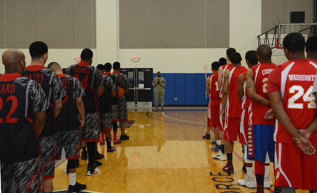 Basketball teams gather for the annual March Madness opening ceremony March 19, 2016, at Andersen Air Force Base, Guam. March Madness is a Pacific-wide basketball tournament which will be held March 19-27. (U.S. Air Force photo/Airman 1st Class Arielle Vasquez)