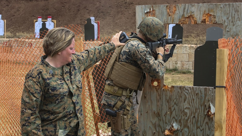Gunnery Sgt. Tanya Fitch, a small arms instructor with Headquarters Battalion, times Lance Cpl. Drew Dodd, a rifleman with Fox Company, 2nd Battalion, 3rd Marine Regiment, during the Pacific Combat Shooting Match at the Kaneohe Bay Range Training Facility aboard Marine Corps Base Hawaii, March 16, 2016. Teams from different units used various weapons and tactics to achieve the fastest time possible on different courses of fire, while earning points for awards during the competition. Marines from the Marine Corps Combat Shooting Team instructed and gave advice to the Marines participating in the event.