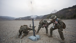 From left, U.S. Marine Corps Lance Cpl. Dave Hermansen and Lance Cpl. Jabril Giannotti, mortarmen, and Sgt. Jack Williams, a squad leader, all assigned to Weapons Co., Battalion Landing Team, 1st Battalion 5th Marines, 31st Marine Expeditionary Unit, fire a 81mm training mortar with the M252A2 mortar system during Ssang Yong 16 at Suseongri, South Korea, March 15, 2016. Ssang Yong familiarizes American armed forces with the Korean Peninsula and contributes to the security and stability of the Asia-Pacific region. Hermansen is a native of Westbrook, Connecticut. Giannotti is a native of Highland Park, New Jersey. Williams is a native of Pilot Point, Texas.