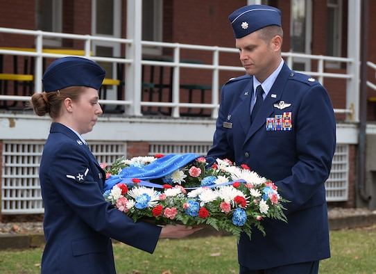 During a remembrance ceremony to honor six Airmen who made the ultimate sacrifice 35 years ago, U.S. Air Force Airman Corale Cobb, 45th Reconnaissance Squadron, and U.S. Air Force Col. Brian Thomas, 45th RS commander, place a wreath next to a monument outside the squadron that memorializes them March 15, 2016, at Offutt Air Force Base, Neb. The Airmen lost their lives when an RC-135S Cobra Ball 664 crashed upon landing at Shemya Air Force Base, Alaska. (U.S. Air Force photo by Kendra Williams)