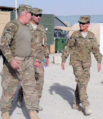 Army Command Sgt. Maj. Frank Grippe, the senior noncommissioned officer for U.S. Central Command, accompanies Army Command Sgt. Maj. John Morales, the senior noncommissioned officer for the 2nd Battalion, 2nd Infantry Regiment, and Command Sgt. Maj. Billie Jo Boersma, the senior noncommissioned officer for the 3rd Infantry Brigade Combat Team, to dinner at Forward Operating Base Apache, Afghanistan, July 23, 2013. Army photo by Sgt. Kandi Huggins