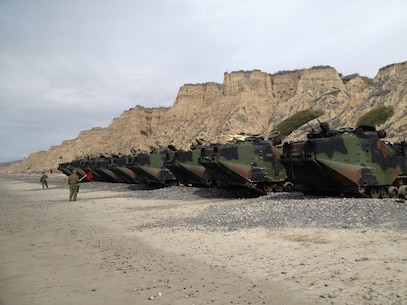 Tracks are staged on the beach before students commence basic water training. Under the guidance and supervision of the instructors, the students will drive the AAVs into the water at Camp Pendleton.