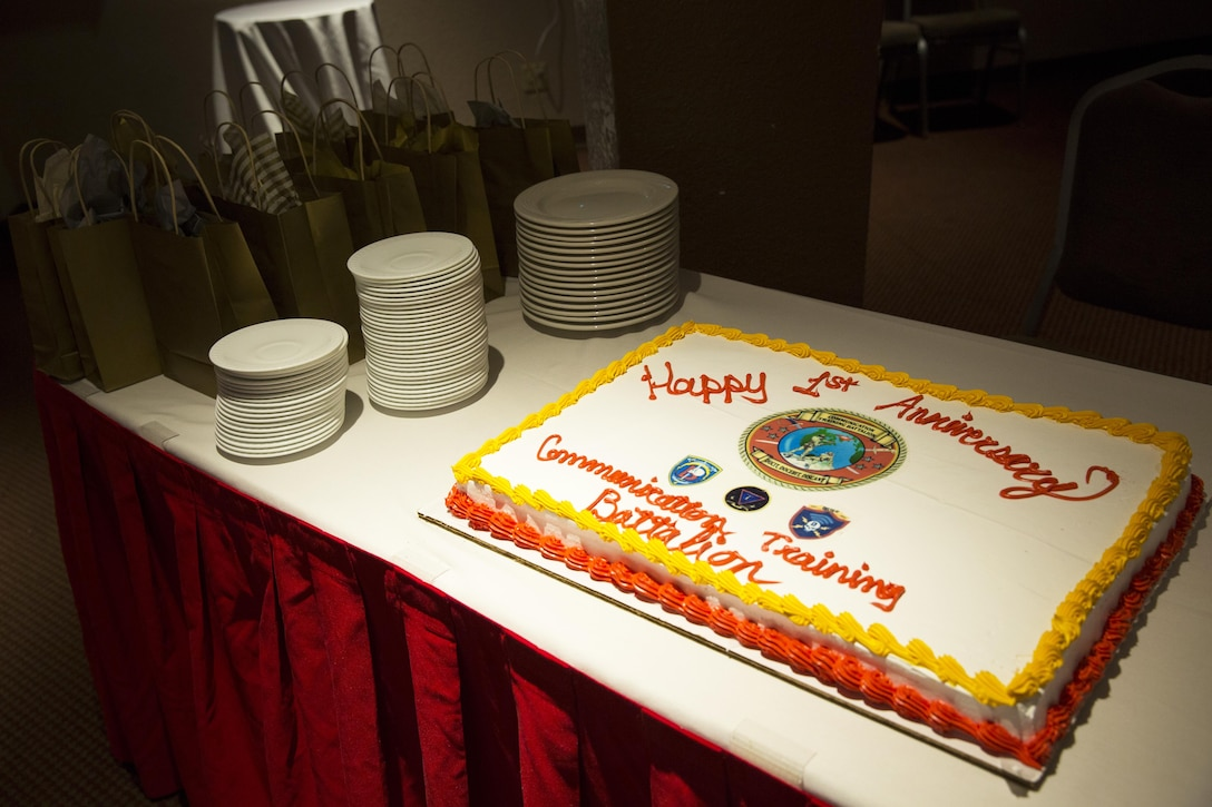 Communication Training Battalion, Marine Corps Communication-Electronics School, celebrates their first year with an anniversary cake at the Officer's Club March 10, 2016. The battalion, activated March 12, 2015, brought the training of enlisted and commissioned communication Marines under one command. (Official Marine Corps photo by Lance Cpl. Levi Schultz/Released)
