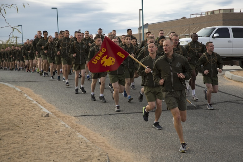 Company B, Communication Training Battalion, Marine Corps Communication-Electronics School, runs in formation during a three-mile motivational run in honor of the battalion anniversary aboard the Combat Center March 11, 2016. The battalion, activated March 12, 2015, brought the training of enlisted and commissioned communication Marines under one command. (Official Marine Corps photo by Lance Cpl. Levi Schultz/Released)
