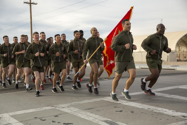 Lt. Col. Speros C. Koumparakis, commanding officer, Communication Training Battalion, Marine Corps Communication-Electronics School, participates in the battalion's three-mile motivational run in honor of the battalion's anniversary aboard the Combat Center March 11, 2016. The battalion, activated March 12, 2015, brought the training of enlisted and commissioned communication Marines under one command. (Official Marine Corps photo by Lance Cpl. Levi Schultz/Released)