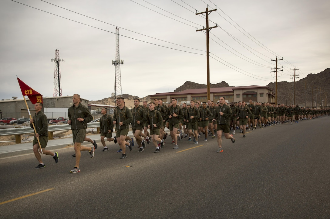 Marines with Communication Training Battalion, Marine Corps Communication-Electronics School, run in formation during the battalion's three-mile motivational run in honor of the battalion's anniversary aboard the Combat Center March 11, 2016. The battalion, activated March 12, 2015, brought the training of enlisted and commissioned communication Marines under one command. (Official Marine Corps photo by Lance Cpl. Levi Schultz/Released)