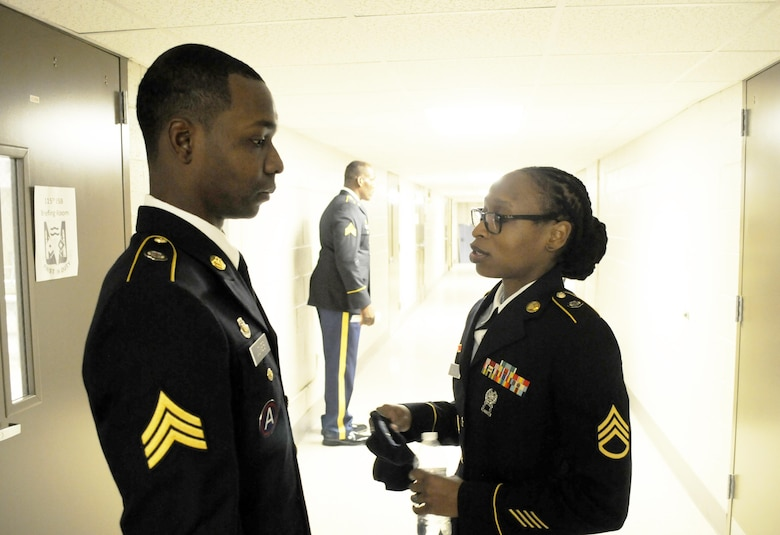 U.S. Army Sgt. Wayne Jones of Gainesville, Ga., a team leader with the 461st Human Resources Company, talks to his sponsor Staff Sgt. Makeisha L. Evans of Greenville, S.C., prior to a examination board for the 642nd Regional Support Group's Best Warrior Competition at Fort McClellan, Ala., Feb. 20. (U.S. Army photo by Sgt. 1st Class Gary A. Witte, 642nd Regional Support Group)