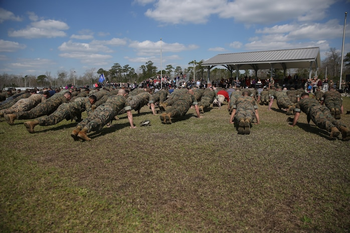 "The Marine Raider Memorial March closing ceremony concluded with a ""25 and 5"" push up event at Stone Bay aboard Marine Corps Base Camp Lejeune, N.C., March 21, 2016. The Marine Raider Memorial March was designed to honor the seven Marine Raiders who died on March 10th, 2015 and their families, as well as bring awareness to their sacrifice."