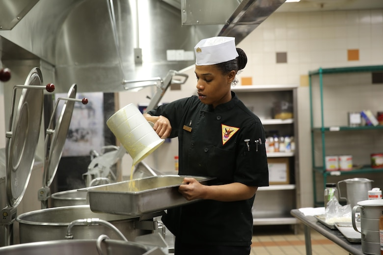 Sgt. Fatimah Butler prepares corn chowder for the Chef of the Quarter Competition at the Marine Corps Air Station Cherry Point, N.C., mess hall, March 17, 2016. Three Marines competed this quarter, and Butler was named the winner. Butler will move on to the Chef of the Year Competition and compete with the other Chef of the Quarter winners. (U.S. Marine Corps photo by Lance Cpl. Mackenzie Gibson/Released)