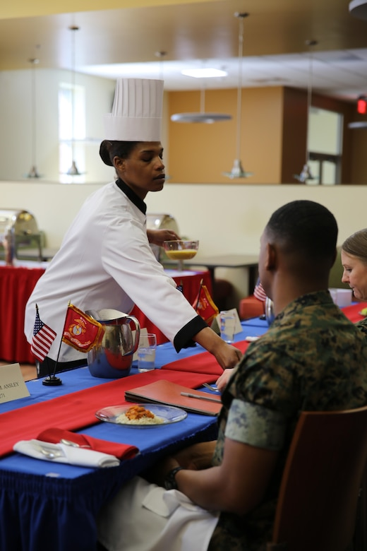Sgt. Fatimah Butler presents her dish for the Chef of the Quarter Competition at the Marine Corps Air Station Cherry Point, N.C., mess hall, March 17, 2016. Three Marines competed this quarter, and Butler was named the winner. Butler will move on to the Chef of the Year Competition and compete with the other Chef of the Quarter winners. (U.S. Marine Corps photo by Lance Cpl. Mackenzie Gibson/Released)