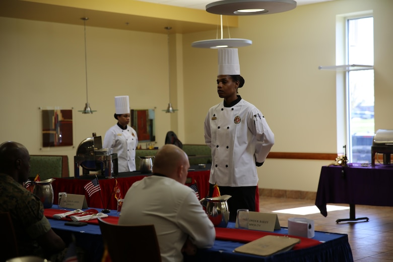 Sgt. Fatimah Butler presents her dishes to the judges at the Chef of the Quarter Competition at the Marine Corps Air Station Cherry Point, N.C., mess hall, March 17, 2016. Three Marines competed this quarter, and Butler was named the winner. Butler will move on to the Chef of the Year Competition and compete with the other Chef of the Quarter winners. (U.S. Marine Corps photo by Lance Cpl. Mackenzie Gibson/Released)