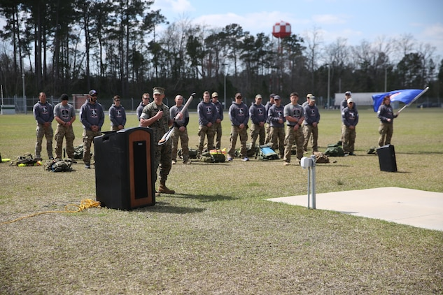 Lieutenant Col. Craig Wolfenbarger, commanding officer of 2nd Marine Raider Battalion, spoke at the conclusion of the Marine Raider Memorial March after he was presented the paddle that was recovered from the wreckage. The Marine Raider Memorial March was designed to honor the seven Marine Raiders who died on March 10th, 2015 and their families, as well as bring awareness to their sacrifice. There was a short ceremony to honor the fallen at Stone Bay aboard Marine Corps Base Camp Lejeune, N.C., March 21, 2016.