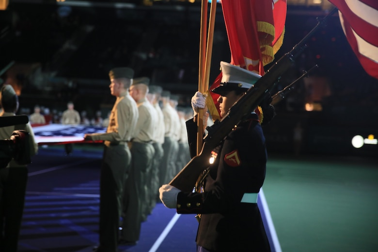 The Combat Center Color Guard marches onto the tennis court during the 14th annual Banque Nationale de Paris Paribas Open's Salute to Heroes at the Indian Wells Tennis Garden in Indian Wells, Calif., March 11, 2016. (Official Marine Corps photo by Cpl. Julio McGraw/Released)