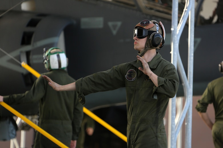 Lance Cpl. Devyn Wildcat directs an TAV-8B Harrier pilot prior to take off at Marine Corps Air Station Cherry Point, N.C., March 11, 2016. A plane captain is responsible for conducting a final examination of the aircraft and guiding the pilots out onto the runway. Plane captains possess extensive knowledge of their designated aircraft and can determine if there are any last minute discrepancies that could potentially ground the aircraft. Wildcat is a plane captain and a fixed-wing aircraft mechanic with Marine Attack Training Squadron 203.  (U.S. Marine Corps photo by Cpl. N.W. Huertas/Released)
