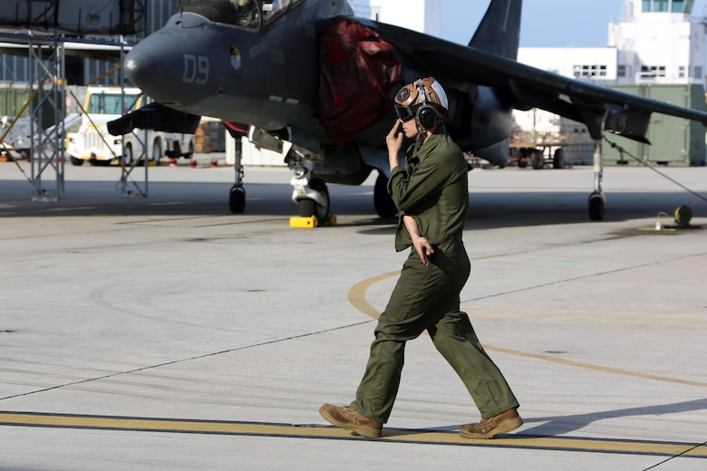 Lance Cpl. Devyn Wildcat directs an TAV-8B Harrier pilot prior to take off at Marine Corps Air Station Cherry Point, N.C., March 11, 2016. A plane captain is responsible for conducting a final examination of the aircraft and guiding the pilots out onto the runway. Plane captains possess extensive knowledge of their designated aircraft and can determine if there are any last minute discrepancies that could potentially ground the aircraft. Wildcat is a plane captain and a fixed-wing aircraft mechanic with Marine Attack Training Squadron 203. (U.S. Marine Corps photo by Cpl. N.W. Huertas/ Released)