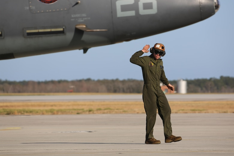 Lance Cpl. Robert Tipton directs an TAV-8B Harrier pilot prior to take off at Marine Corps Air Station Cherry Point, N.C., March 11, 2016. A plane captain is responsible for conducting a final examination of the aircraft and guiding the pilots out onto the runway. Plane captains possess extensive knowledge of their designated aircraft and can determine if there are any last minute discrepancies that could potentially ground the aircraft. Tipton is a plane captain and a fixed-wing aircraft mechanic with Marine Attack Training Squadron 203. (U.S. Marine Corps photo by Cpl. N.W. Huertas/ Released)