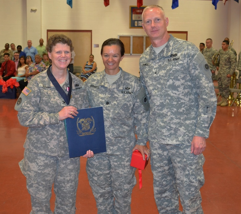 Col. Amy Taitano (left), commander, 650th Regional Support Group, was inducted into the Honorable Order of Saint Martin and was awarded the Meritorious Service Medal, Las Vegas, June 28, 2015. The Honorable Order of Saint Martin recognizes those individuals who have demonstrated the highest standards of integrity, moral character and have displayed an outstanding degree of professional competence.