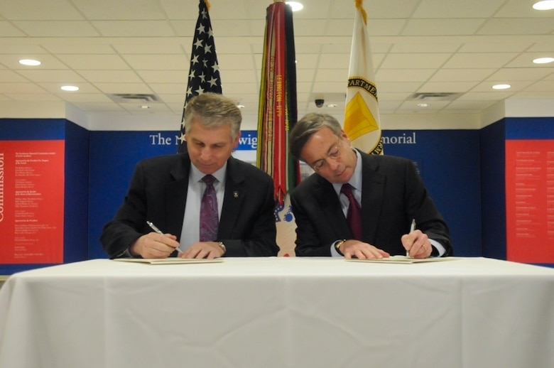 Stephen Austin, assistant chief of Army Reserve, and Sidney Goodfriend, founder and chairman of American Corporate Partners, sign a partnership agreement at the Pentagon in Washington March 21. The partnership launched the new Women's Veteran Mentoring Program initiative.