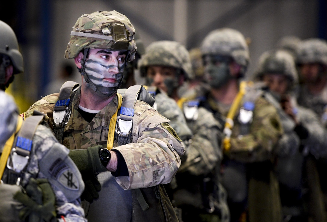 U.S. Army Reserve Maj. Jay Favuzzi, 412th Civil Affairs Battalion civil military operations center chief, stands in line while waiting to walk to a waiting U.S. Marine Corps KC-130J aircraft to conduct a jump over Wright-Patterson Air Force Base, Ohio, March 19, 2016. The KC-130J aircraft are from the 252 Marine Aerial Refueler Transport Squadron, Marine Aircraft Group 14, 2nd Marine Aerial Wing, Marine Corps Air Station, Cherry Point, N.C. (U.S. Air Force photo by Wesley Farnsworth/Released)