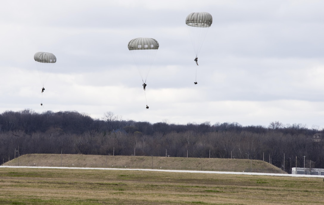 Members of the U.S. Army Reserve's 412th Civil Affairs Battalion, Columbus, Ohio, jump from 1250 feet from a KC-130J aircraft from the 252 Marine Aerial Refueler Transport Squadron, Marine Aircraft Group 14, 2nd Marine Aerial Wing, Marine Corps Air Station, Cherry Point, N.C., over Wright-Patterson Air Force Base, Ohio, March 19, 2016. When deployed, the unit conducts civil affairs operations in support of Central Command's theater and task force commanders. Soldiers of the 412th Civil Affairs Battalion have been on the front lines of operations in Iraq, Afghanistan and in the Horn of Africa. (U.S. Air Force photo by Wesley Farnsworth/Released)