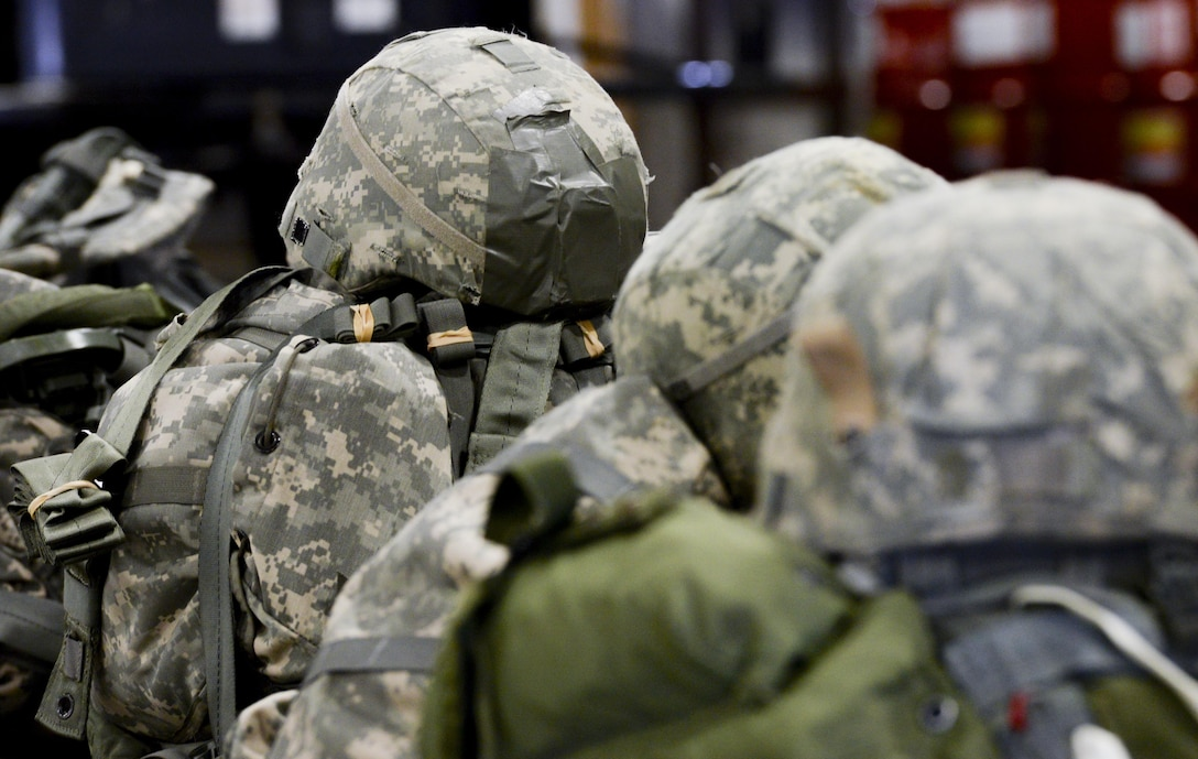 Soldiers gear from the U.S. Army Reserve's, 412th Civil Affairs Battalion, Columbus, Ohio, lay on the floor in straight lines after a successful static line jump over Wright-Patterson Air Force Base, Ohio, March 19, 2016. This jump was the first in almost 20 years to be conducted at Wright-Patterson by any unit. (U.S. Air Force photo by Wesley Farnsworth / Released)