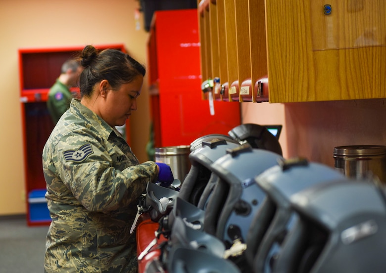 Staff Sgt. Anna North, 366th Operations Support Squadron aircrew flight equipment journeyman, cleans helmets at Mountain Home Air Force Base, Idaho. Airmen from Aircrew Flight Equipment are responsible for inspecting flight equipment such as protective clothing, flotation equipment, emergency evacuation systems and parachutes. (U.S. Air Force photo by Airman Alaysia Berry/RELEASED)