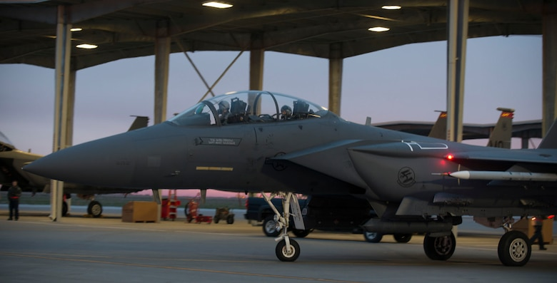 An F-15E Strike Eagle taxi to a runway at Mountain Home Air Force Base, Idaho, March 15, 2016. Airmen from the 366 Operations Group and the 366th Maintenance Group participated in sortie surge, a 72-hour readiness exercise. (U.S. Air Force photo by Senior Airman Malissa Lott/ RELEASED)