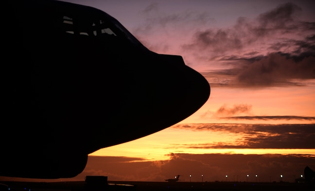 A B-52 Stratofortress sits on the flightline March 21, 2016, at Andersen Air Force Base, Guam. The strategic global strike capability of B-52's deters potential adversaries and provides reassurance to allies and partners that the U.S. is capable to defend its national security interests in the Indo-Asia-Pacific region. (U.S. Air Force photo by Senior Airman Joshua Smoot/Released)