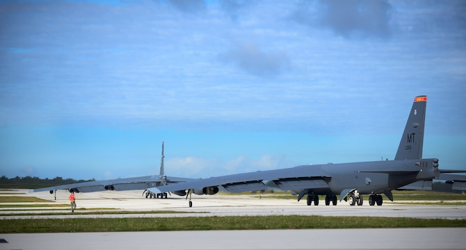 Two B-52 Stratofortresses taxi on the runway March 21, 2016, at Andersen Air Force Base, Guam. The U.S. military has maintained a deployed strategic bomber presence in the Pacific since March 2004, which has contributed significantly to regional security and stability. (U.S. Air Force photo by Senior Airman Joshua Smoot/Released)
