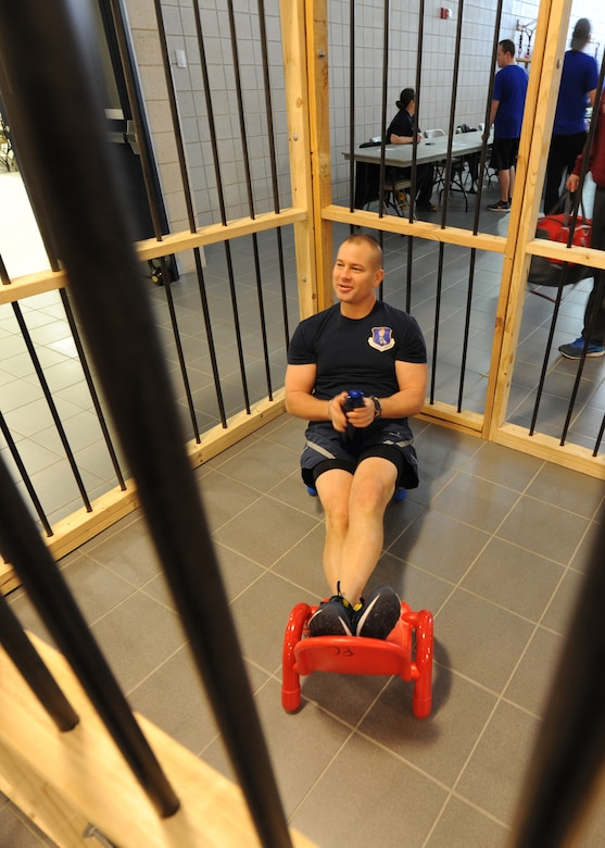 Chief Master Sgt. Todd Krulcik, 319th Air Base Wing command chief, relaxes in jail during the 2016 Winter Bash March 18, 2016, on Grand Forks Air Force Base, N.D. The 319th Security Forces Squadron morale club allowed Airmen to pay to have their friends imprisoned in the Jail-N-Bail to raise money for future events. (U.S. Air Force photo by Airman 1st Class Ryan Sparks/Released)