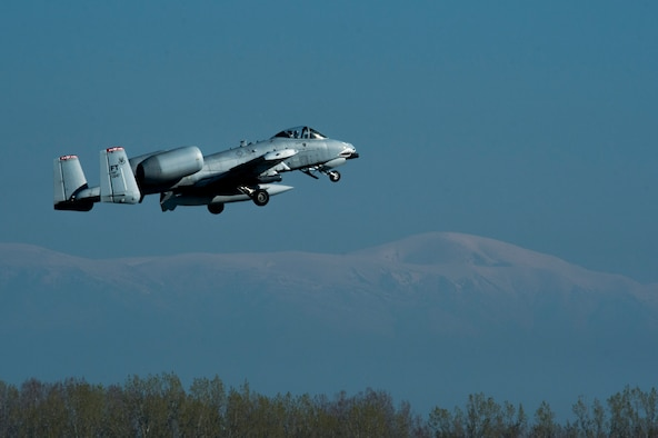 A U.S. Air Force A-10 Thunderbolt II pilot assigned to the 74th Expeditionary Fighter Squadron flies over the flightline during the 74th EFS's deployment in support of Operation Atlantic Resolve at Graf Ignatievo, Bulgaria, March 18, 2016. The U.S. Air Force and other services have increased their rotational presence in Europe to reassure allies and partner nations about the U.S.'s commitment to European security and stability. (U.S. Air Force photo by Staff Sgt. Joe W. McFadden/Released)
