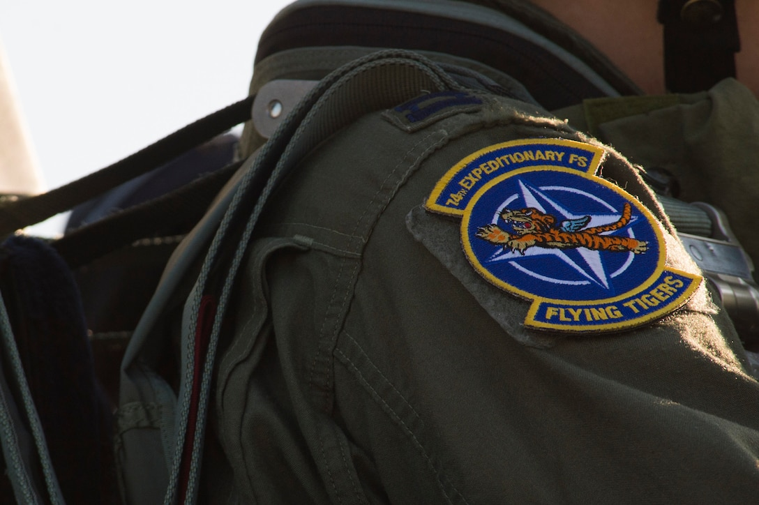 A 74th Expeditionary Fighter Squadron patch is displayed on the shoulder of U.S. Air Force Capt. Chandra Fleming, a 74th EFS A-10 Thunderbolt II pilot, during the 74th EFS's deployment in support of Operation Atlantic Resolve at Graf Ignatievo, Bulgaria, March 18, 2016. The patch incorporates the squadron's legacy which dates back to the original 'Flying Tigers' who served in the Burma-Indo-China Theater during World War II. (U.S. Air Force photo by Staff Sgt. Joe W. McFadden/Released)