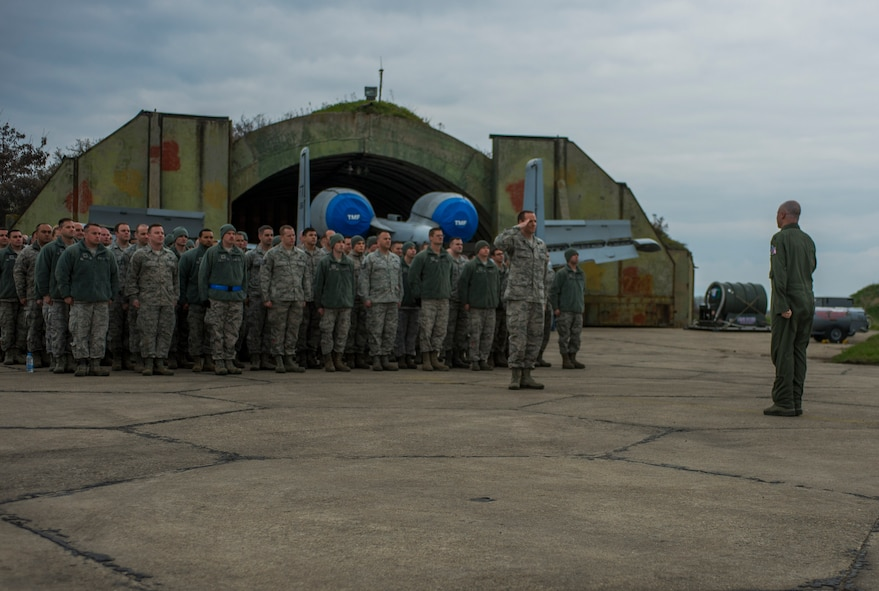 U.S. Air Force Lt. Col. Bryan France, 74th Expeditionary Fighter Squadron commander, right, salutes U.S. Air Force 1st Lt. Jason Story, 74th EFS maintenance officer, before addressing a flight of maintenance Airmen during the 74th EFS's deployment in support of Operation Atlantic Resolve at Graf Ignatievo, Bulgaria, March 16, 2016. France touted the maintainers' ability to generate thousands of sorties during their six-month deployment throughout countries in Eastern Europe. (U.S. Air Force photo by Staff Sgt. Joe W. McFadden/Released)