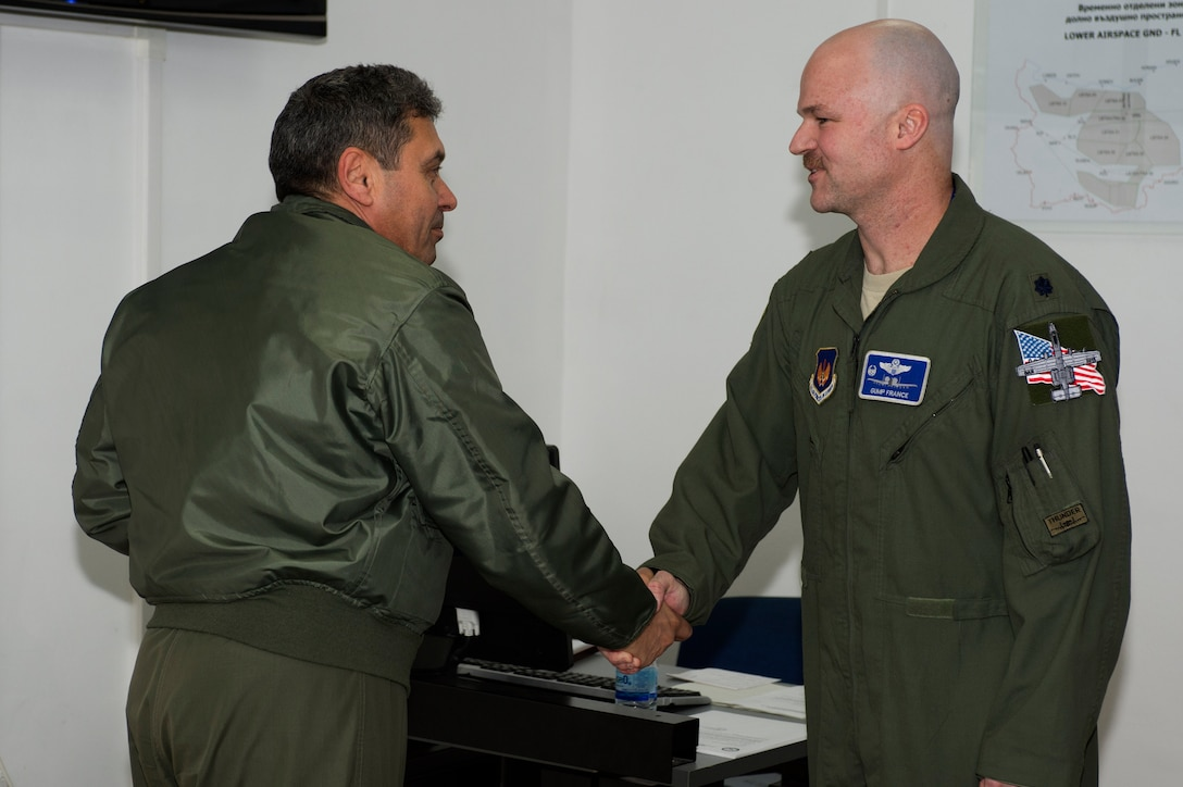 Bulgarian air force Brig. Gen. Ivan Lalov, 3rd Air Force Base commander, left, shakes the hand of U.S. Air Force Lt. Col. Bryan France, 74th Expeditionary Fighter Squadron commander, right, during the 74th EFS's deployment in support of Operation Atlantic Resolve at Graf Ignatievo, Bulgaria, March 16, 2016. The 74th EFS participated in a six-month deployment to Eastern Europe which began at Amari Air Base, Estonia, and concluded at Graf Ignatievo. (U.S. Air Force photo by Staff Sgt. Joe W. McFadden/Released)