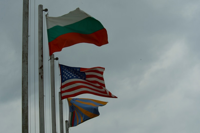 The Bulgarian and United States flags wave on flagpoles outside the Bulgarian air force 3rd Air Force Base headquarters at Graf Ignatievo, Bulgaria, March 16, 2016. The Bulgarians hosted the U.S. Air Force's 74th Expeditionary Fighter Squadron which completed a six-month deployment to Eastern Europe March 18, 2016, in support of Operation Atlantic Resolve. (U.S. Air Force photo by Staff Sgt. Joe W. McFadden/Released)