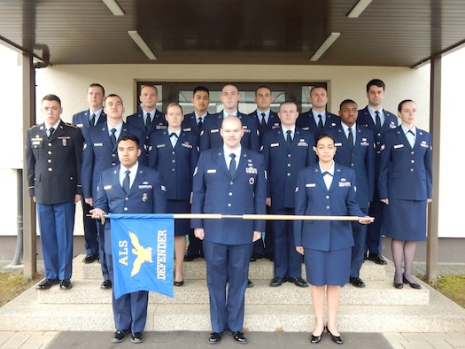 Defender flight poses in front of the Airman Leadership School building March 15, 2016, at Vogelweh Air Base, Germany. On the far left, Spc. Dean Iversen, 92nd Military Police Battalion gunner, is the first soldier to attend ALS in U.S. Air Forces in Europe's history. (Courtesy photo)