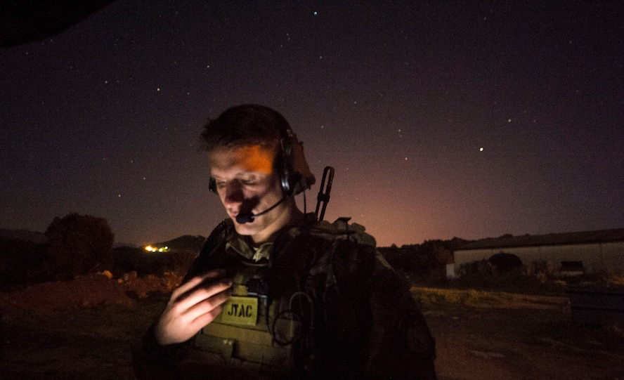 Senior Airman Tormod Lillekroken, 2nd Air Support Operations Squadron joint terminal attack controller, reviews training objectives as part of a night training scenario during Exercise Serpentex '16 in Corsica, France, March 15, 2016. Lillekroken recently reached his goal to be qualified as a joint terminal attack controller. Lillekroken has been in the tactical air control party career field for more than four years. (U.S. Air Force photo/Staff Sgt. Sara Keller)