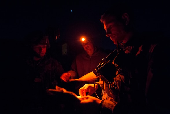 Tech. Sgt. Jeremy Rarang, Senior Airman Tormod Lillekroken, 2nd Air Support Operations Squadron joint terminal attack controllers, and Master Bombardier Mathiew Marcoux-Desrochers, a joint terminal attack controller from the Yankee Battery of the 2nd Regiment, Royal Canadian Horse Artillery, discuss training objectives as part of a night training scenario during Exercise Serpentex '16 in Corsica, France, March 15, 2016. Lillekroken grew up in Stange, Norway, and left to live in America when he was 20 years old. He joined the U.S. Air Force three years later to become a part of the tactical air control party career field. (U.S. Air Force photo/Staff Sgt. Sara Keller)