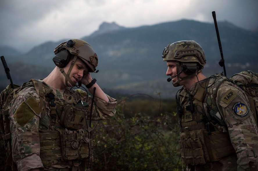 Senior Airman Tormod Lillekroken and Staff Sgt. Seth Hunt, 2nd Air Support Operations Squadron joint terminal attack controllers, talk about a training scenario during Exercise Serpentex '16 in Corsica, France, March 15, 2016. Approximately 215 U.S. Air Force Airmen, including four JTACs from the 2nd ASOS, participated in an annual exercise held at NATO's tactical training center and the French air force's Air Base 126 Solenzara . (U.S. Air Force photo/Staff Sgt. Sara Keller)
