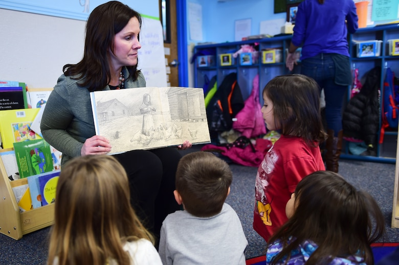 Tess Marcial, 460th Medical Group medical logistics contract specialist, encourages the children to write their own story during a Women's History Month book reading March 18, 2016, at the Crested Butte Child Development Center, on Buckley Air Force Base, Colo. Esther Blake, an Air Force trailblazer for women, enlisted the first minute of the first hour of the first day regular United States Air Force duty was authorized for women on July 8, 1948. (U.S. Air Force photo by Senior Airman Racheal E. Watson/Released)