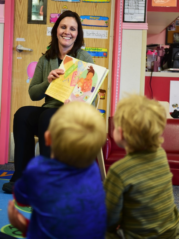 """Tess Marcial, 460th Medical Group medical logistics contract specialist, asks questions to the children during a Women's History Month book reading March 18, 2016, at the Crested Butte Child Development Center, on Buckley Air Force Base, Colo. Between 1988 and 1994, Congress passed resolutions requesting and authorizing the President to proclaim March of each year as Women's History Month. Annual proclamations from Presidents Clinton, Bush and Obama have been issued designating the month of March as """"Women's History Month."""" (U.S. Air Force photo by Senior Airman Racheal E. Watson/Released)"""