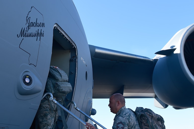 Members of the 140th Wing board a C-17 Globemaster III March 16, 2015, on Buckley Air Force Base, Colo. The 140th Wing transported Airmen and some equipment to Tyndall AFB, Florida, to participate in an Air-to-Air Weapons Engagement Program exercise. (U.S. Air Force photo by Airman 1st Class Luke W. Nowakowski/Released)