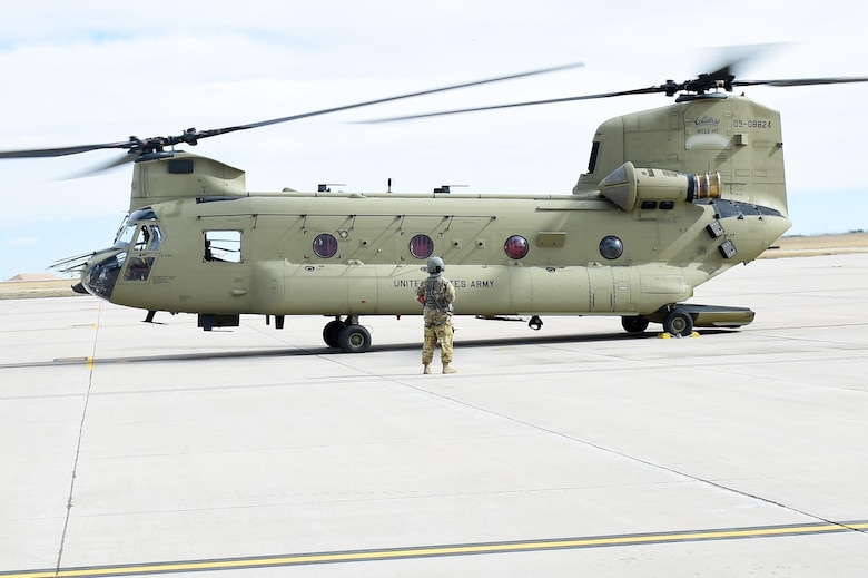U.S. Army Sgt. Benjamin Stocker, Colorado Army National Guard CH-47 flight engineer and mechanic, does an engine check on his helicopter March 3, 2016, at the Army Aviation Support Facility on Buckley Air Force Base, Colo. The crew chief is responsible for ensuring the aircraft is safe and ready to go before flights by looking and listening to how the engine runs. (U.S. Air Force photo by Airman 1st Class Gabrielle Spradling/Released)