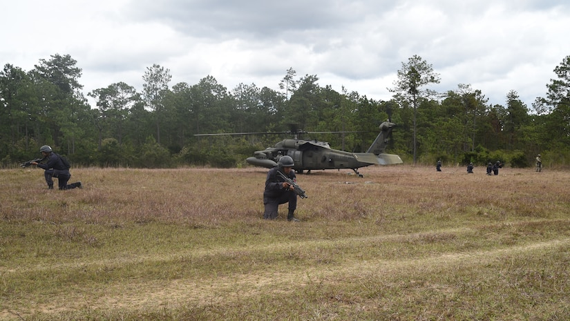 Combat Nurses, safeguard the loading of a U.S. Army UH-60 Black Hawk helicopter during a personnel recovery exercise, March 10, 2016, near Soto Cano Air Base, Honduras. During this exercise U.S. medical, rescue and aviation assets and Honduran combat medical forces joined together to validate their ability to respond to a simulated downed aircraft in a remote area. (U.S. Army photo by Martin Chahin/Released)