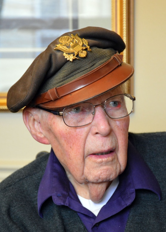 Retired World War II navigator Lt. Col. Leonard Erickson discusses his military service with 120th Airlift Wing Chaplain, Lt. Col. Arthur McCaffrey, at an assisted living facility in Butte, Mont., March 10, 2016. Erickson served as a navigator for DH 98 Mosquito and B-17 Flying Fortresses during the war. (U.S. Air National Guard photo by Senior Master Sgt. Eric Peterson) (U.S. Air National Guard photo by Senior Master Sgt. Eric Peterson/Released)