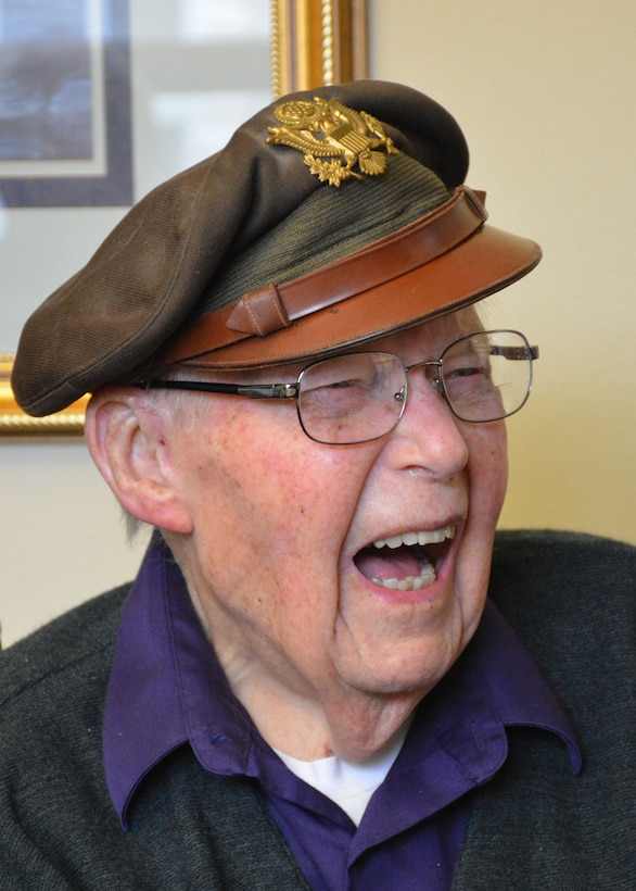Retired World War II navigator Lt. Col. Leonard Erickson shares a humorous story during a visit with 120th Airlift Wing Chaplain, Lt. Col. Arthur McCaffrey, at an assisted living facility in Butte, Mont., March 10, 2016. Erickson served as a navigator for DH 98 Mosquito and B-17 Flying Fortresses during the war. (U.S. Air National Guard photo by Senior Master Sgt. Eric Peterson/Released)