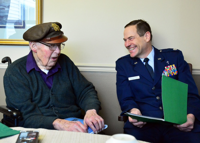 Retired Lt. Col. Leonard Erickson shares his experience as a World War II United States Army Air Forces navigator with 120th Airlift Wing Chaplain, Lt. Col. Arthur McCaffrey, at an assisted living facility in Butte, Mont., March 10, 2016. (U.S. Air National Guard photo by Senior Master Sgt. Eric Peterson/Released)